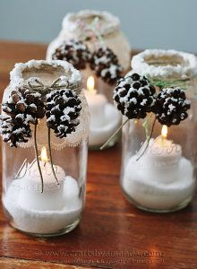 Snowy Pinecone Candle Jars, one of 15 winter decor crafts. Mason Jar Christmas Decorations, Christmas Lanterns, Christmas Mason Jars, Noel Christmas, Rustic Christmas, Winter Decorations, Christmas Ideas, Holiday Candles, Wedding Decorations
