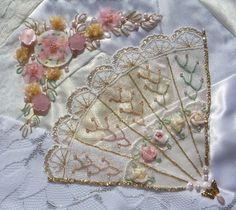 I ❤ crazy quilting & ribbon embroidery . . . Fool's Gold RR - Block Barbara embellished for me- This is the lovely block which Barbara Warner stitched on for me. I love this beautiful fan she did and the lovely floral spray!  I pieced all my blocks from wedding dress fabrics and my request from the others was pretty vague - that I would like something romantic.   Barbara hit the nail on the head as far as I am concerned.  Thank you Barbara!! ~By kerrykatiecakes