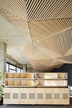 The new Assemble Studio with its geometric ceiling influenced by Origami