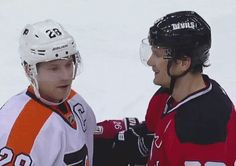 Claude Giroux and Patrik Elias during a scrum in their game 1/23/12. Giroux's little smile is the cutest :)