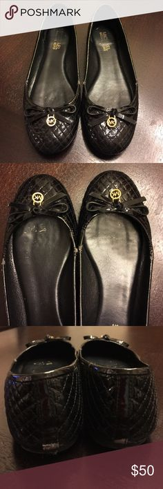 Michael Kors Patent Flats Black slip ons with gold accent! Have wear shown in pics but have life left. I always got compliments in these shoes and they are super comfortable Michael Kors Shoes Flats & Loafers
