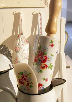 flowers adorn rolling pin and spatula set in enamelware pitcher