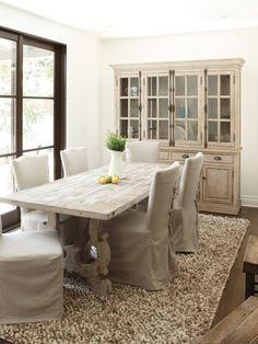 Raw Wood Slab Dining table, dark windows, & slipped chairs
