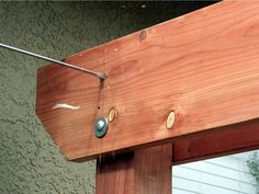 Option for a swing between the garage & the neighbors garage?  With kid swings rather than a porch swing.