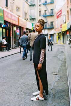Salem Mitchell, 18, in her own black T-shirt and skirt, a Gucci printed blouse, and Ace sneakers with crystal mouth appliqué. Produced by Vogue for Gucci.