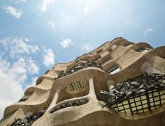 """Casa Milà Casa Milà popularly known as La Pedrera or """"The stone quarry"""" a reference to its unconventional rough-hewn appearance is a modernist building in Barcelona Catalonia Spain. Picture by Tyler Hendy Famous Buildings, Dubai City, Antoni Gaudi, Weekends Away, Le Corbusier, Barcelona Spain, Historical Sites, Around The Worlds, Vacation"""