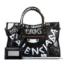 Balenciaga Classic City Aj Small Graffiti Satchel Bag (8.255 RON) ❤ liked on Polyvore featuring bags, handbags, black, satchels, satchel handbags, leather tote handbags, handbag satchel, studded leather handbags and leather totes