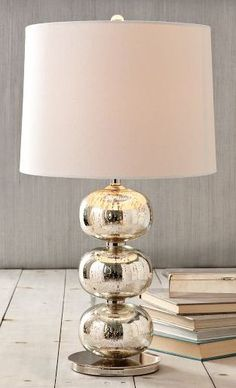 Unique home accessories, such as this mercury glass lamp, help convey your personality through your decorating