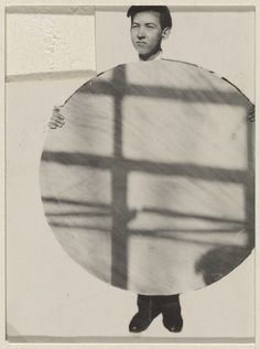 Photoplastik, Japanese Student at Bauhaus Holding Circle of Shadows, Germany, 1928, photograph by Edmund Collein.