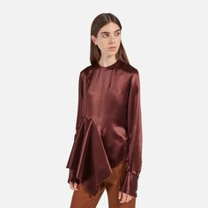 Shop the Vicky Blouse in Chestnut Duchess Satin at Mulberry.com. Made in shiny chestnut duchess satin crepe, the Vicky Blouse is designed to give a relaxed and elegant silhouette. It features an asymmetric ruffled hem and button fastenings to the back.