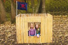 Fort made from fencing. Not sure where the door is on this, but this design could be tweaked to what we need.