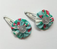 Baby hair clips with green and pink flower hair by Minimelton