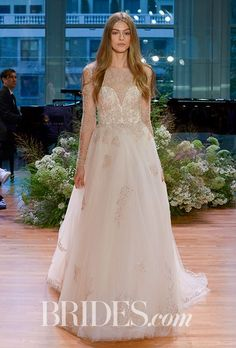 "Brides.com: . ""Rhapsody,"" blush illusion long sleeve floral embellished a-line wedding dress by Monique Lhuillier #wedding #weddingdress"