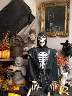 Halloween Decorations 2016-- My skelly all dressed up in his skelly costume surrounded by zombies and more skeletons.
