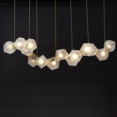 In addition to the metallic versions, there is also a linear chandelier that features hand blown glass.