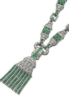 EMERALD AND DIAMOND SAUTOIR, 1930S Designed as a series of pierced geometric plaques alternating with rectangular spacers, set with single-cut diamonds and calibré-cut emeralds, suspending to the front a tassel set with similar stones, together with brilliant- and circular-cut diamonds.