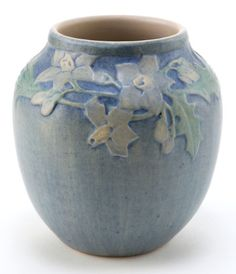 A NEWCOMB POTTERY VASE. Newcomb Pottery, New Orleans, Louisiana, circa 1918. 4-1/4 inches high (10.8 cm). The blue glazed earthenware vase with molded floral decoration, decorated by Henrietta Davidson Bailey.
