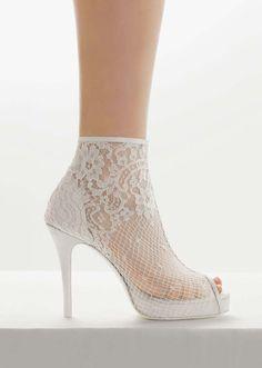 Rosa Clara - botin de rosa clara- interesting  combo of lace with boots.