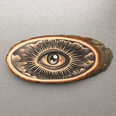 Wood slice with an original drawing of an all seeing eye.  Can be hung on a wall or put on a shelf as decoration.  Done with acrylic marker and copic markers.  The wood slice is about 21x9,5 cm.  If you want to buy multiple items please contact me so i can adjust shipping costs.