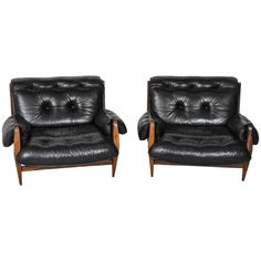 Pair of Jean Gillon Brazilian Lounge Chairs for Italma Wood Art | From a unique collection of antique and modern lounge chairs at https://www.1stdibs.com/furniture/seating/lounge-chairs/