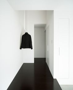White walls and ceiling, black floor, built in cabinets. Simple and effective.