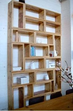 Interesting mix of horizontal and vertical shelves. This set of shelves has a very geometric, and therefore contemporary, vibe. -- I'm cheating on fashion with furniture.Miss Kitty-Cat Goes to Town(Mix Wood Shelves)