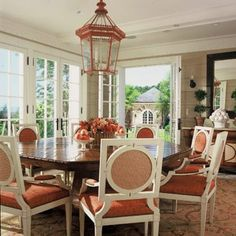Octagonal table, large lantern, topiaries, painted chairs - Thomas Pheasant