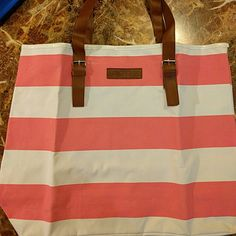 Large travel/tote bag This is a large pink and white striped travel bag or tote/Beach bag. It is made of canvas material with brown fake leather straps. From Aerosoles. New and never used, but there are some light pen marks on the rim (see picture 2). Measures 20 1/2 inches across and 16 1/2 inches in length. AEROSOLES Bags Travel Bags
