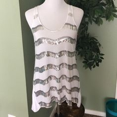 Sequins Tank Top White with silver sequins. Back is solid white. 100% rayon. Lightweight. Price firm. Tops Tank Tops