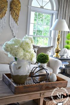I love the idea of putting the coffee table decor on a wooden tray. Looks great and makes it easy to move out of the way when needed!