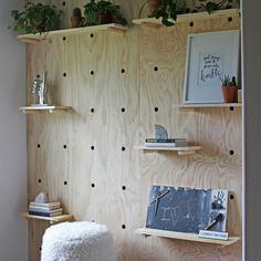 This giant pegboard accent wall is trendy and quite practical. It's an eye-catching addition to an office space, kid's bedroom or casual bonus room.