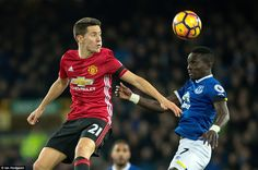 United midfielder Ander Herrera (left) rises above Everton counterpart Idrissa Gueye to win a header