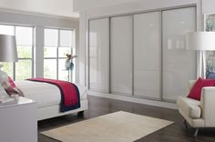 Remarkable Ikea Bedrooms Inspiration Idea Design With White Bed Along Red Blanket Also Beige Carpet On The Hardwood Flooring Plus White Wardrobe Sliding Doors Also Glass Windows As Well As Living Room Furniture Sets Ikea And Ikea Ideas For Living Room, Modern Ikea Ideas And Inspiration Astonishing Design: Interior