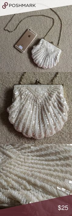 Vintage beaded seashell purse 🐚 Amazing vintage beaded seashell mini bag. Pretty small, doesn't fit my iPhone 6 but super cute for holding credit cards, lipstick, etc. perfect accessory for any beach outfit! Small stain on the inside was there when I purchased, otherwise NO FLAWS.  (Don't like the price? Make me an offer! 😊) Bags Mini Bags