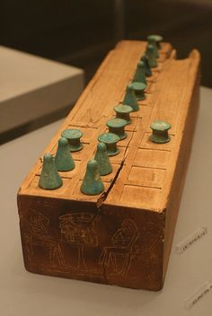 New Kingdom - reign of Thutmose IV–Amenhotep III - ca. - This wooden game box has two playing surfaces and throw sticks that were used as counters for determining moves in the game. The top surface is laid out with twenty squares. The botto Ancient Artifacts, Ancient Egypt, Ancient History, Medieval Games, Amenhotep Iii, Temples, Minoan, Old Games, Egyptian Art