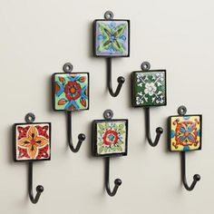 Delicately hand painted in a variation of vibrant floral designs, our set of six Painted Square Tile Hooks coordinate to create a colorful, eclectic look. Crafted of ceramic fitted into a powder-coated metal frame, these unique hooks are easy to hang - plus, they come at a delightful value.