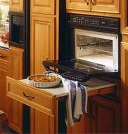pull-out counter beneath a built-in wall oven