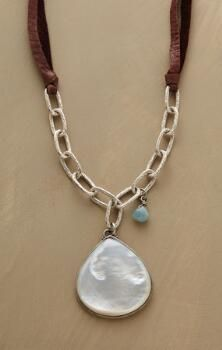 This unique mother-of-pearl pendant necklace glows just like sunlight on surf.