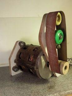 Belt Sander Homemade belt sander constructed from steel stock, bearings, skateboard wheels, plywood, and an electric motor.
