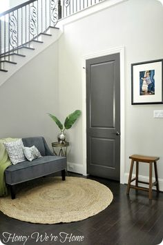 Is the Gray Home Decorating Trend Here to Stay? gray interior door in foyer plus front door & side lites Dark Interior Doors, Dark Doors, Painted Interior Doors, Grey Doors, Gray Interior, Interior Paint, Interior Design, Wood Doors, Painted Doors