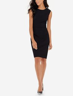 I have last year's version of this dress in black and also in maroon. Love that they are great alone or with a cardigan, form fitting to show curves and modest. Collection V-Back Sheath Dress from THELIMITED.com