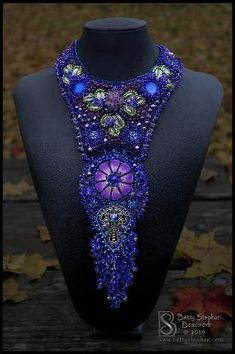 These one of a kind bead embroidered collars are original works of art. Made from semi precious stone cabochons and beads, glass, and found objects, they are truly statement pieces. Bead Embroidery Jewelry, Fabric Jewelry, Beaded Embroidery, Beaded Jewelry, Beaded Necklace, Bib Necklaces, Jewellery, Beaded Collar, Unusual Jewelry