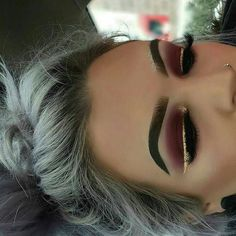 Too much eyebrow make up in my opinion but love the eye shadow