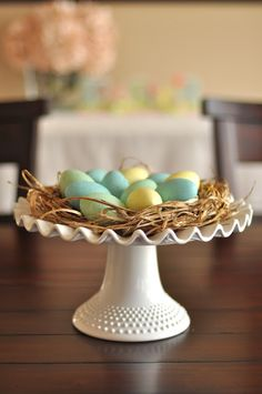 Use a cake stand to elevate an Easter egg centerpiece made with grass from the yard.