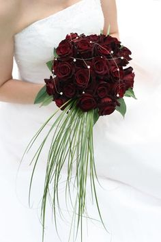 Nice deep red colored wedding flowers. #wedding #weddingflowers #weddingbouquets