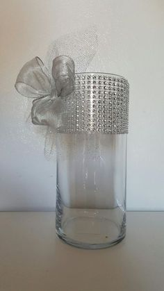 Set of 12 contemporary cylinder vases! 10 tall x 3 1/4 diameter glass vases. Beautiful rhinestone with tulle/organza and ribbon décor. Absolutely stunning. Can be used with diamond confetti (sold separately) to complete an amazing centerpiece for any wedding theme. Equally striking with candles, rose petals or any gems. Please feel free to e-mail me with any questions or custom order requests. Different color ribbon and tulle available on request. You will receive 12 vases in total....