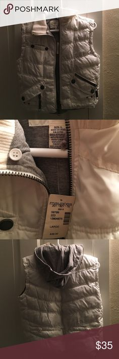 White hooded puffer vest Maurice's white hooded puffer vest. Size L. BRAND NEW WITH TAGS!!! No rips tears or staining. 3 pockets, extra zipper pockets Maurices Tops