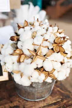 Such a unique idea to use cotton balls for floral arrangements. Love it!