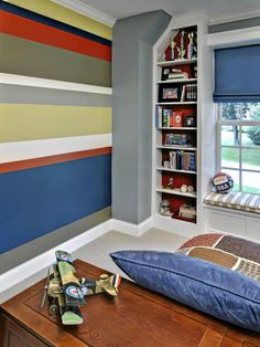 Blue orange striped wall for a teenage boy's bedroom.
