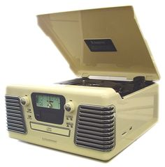 A modern record player disguised as vintage, this record player includes a CD player, USB and SD card slot and much more.